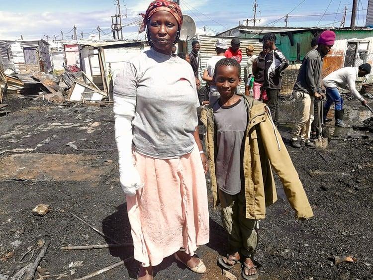 Nondingazi Ntsukumbini pictured with her heroic son Aphelele. Source: GroundUp