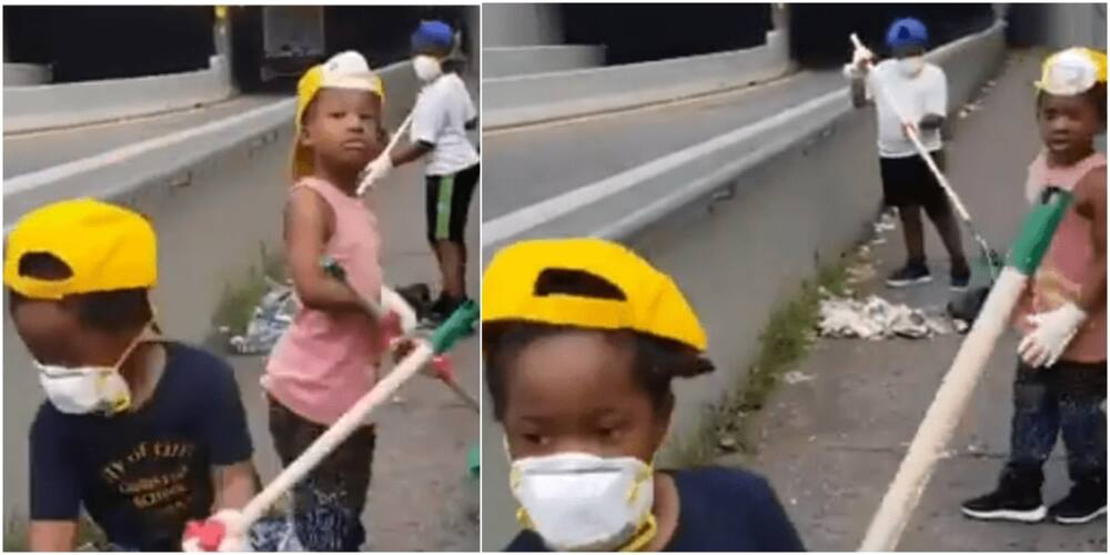 Young kids and their dad clean up the trash on their route to the subway