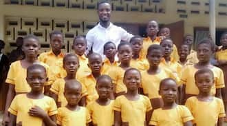 Young teacher sews school uniform for 18 students with monthly salary