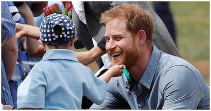 Adorable boy, 5, breaks royal protocol to touch Prince Harry's beard