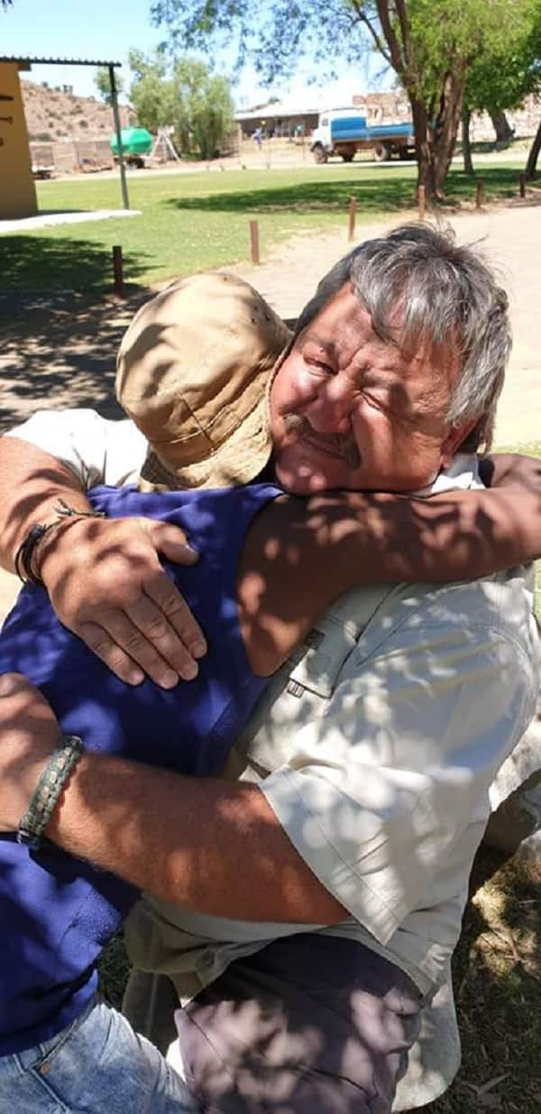 Images of hope: Young man hugs farmer who gave him advise