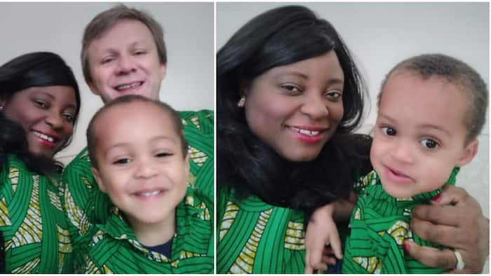 Social media users gush as lady, her hubby and son storm England birthday party in native wear