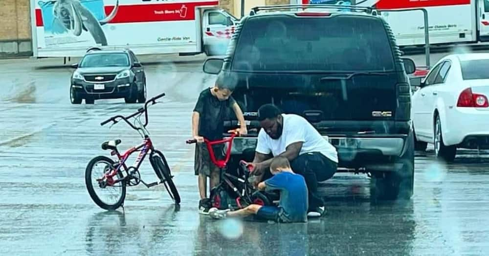 The man had just stepped out of his SUV when he noticed the boy trying to fix his bike.
